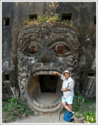 Ready to be swallowed at Buddha Park, Laos–Dec. 2008