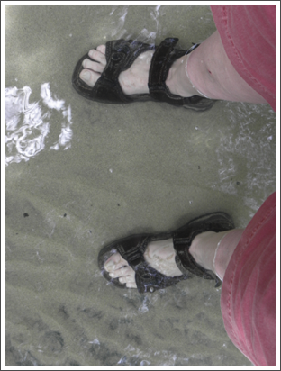 My feets on the sand at Puerto Princesa Cave, Philippines–Feb. 2012
