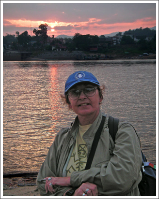 Across the Mekong River, the sun sets over Thailand–Dec. 2008…one of my favorites