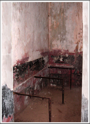 Inside, the cells have remnants of beds and graffiti