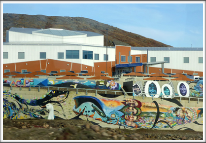 IQALUIT—a wall mural with sea life and Inuit