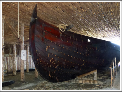 L'ANSE AUX MEADOWS—a replica Viking ship rests inside one of the buildings