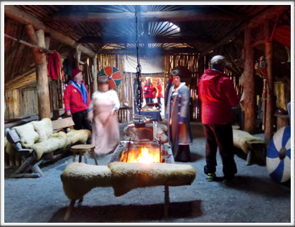 L'ANSE AUX MEADOWS—in the longhouse, costumed reenactors give life to the artifacts inside