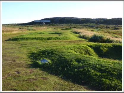 L'ANSE AUX MEADOWS—raised outlines of the buildings of the original settlement circa 1000 CE